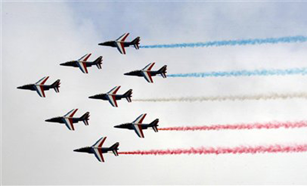 The Patrouille de France display team performs for the inauguration day of the 51st International Paris Air Show. Some 300,000 aviation professionals and spectators are expected at this week's Paris Air Show, coming from around the world to make