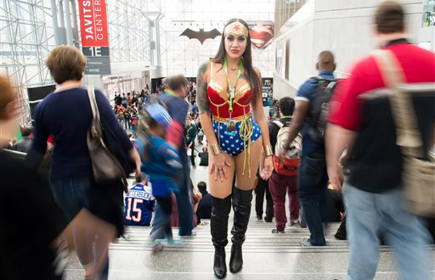An attendee dressed as Wonder Woman walks the floor of New York Comic Con at the Javits Center.