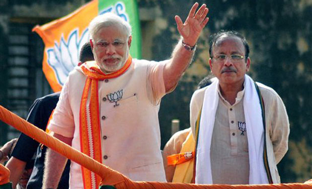 BJP PM candidate Narendra Modi waves during an election road show in Varanasi on Thursday. (Photo: AP)