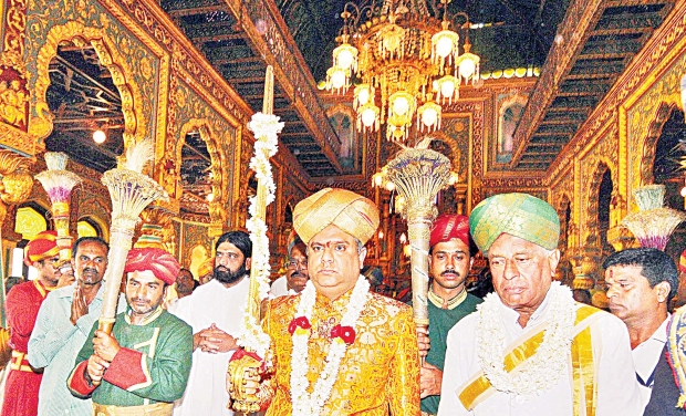 Chaduranga Kantharaj Urs Carries The Royal Sword Before Placing It On Golden Throne At
