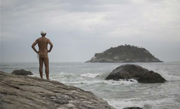 Pedro Ribeiro looks out at the sea from Abrico beach, recently designated as nudist after a 20-year-battle, in Rio de Janeiro, Brazil, Thursday, Dec. 4, 2014. (Photo: AP)