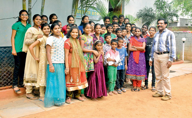 All smiles: David Subramanyam (extreme right) with the children of The Cherish Foundation. (Photo: DC)