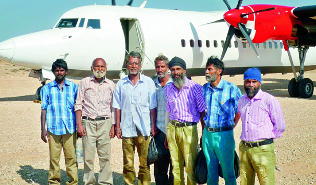 A file photo of seafearer, Bhimsen Singh (fourth from left) along with six others who were held captive by the Somalian Pirates for four years and later released. (Photo: DC)