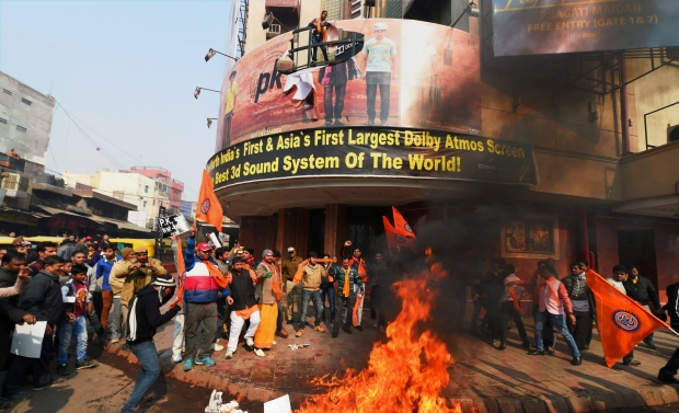 Right wing activists protesting against Aamir Khan starrer 'PK' burn the film's posters outside a movie theatre, in New Delhi on Tuesday (Photo: PTI)