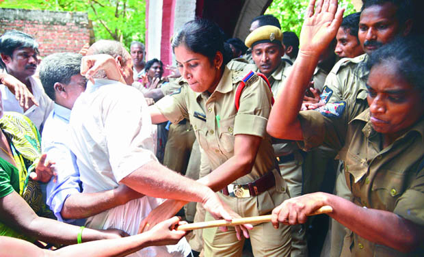Police officials confront the striking municipal workers when they tried to barge into Sub-collector's office in Vijayawada, on Friday. (Photo: DC)
