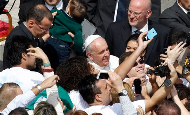 Pope Francis, marking Palm Sunday in a packed St. Peter's Square, ignored his prepared homily and spoke entirely off-the-cuff in a remarkable departure from practice. Later, he continued to stray from the script by hopping off his popemobile to pose