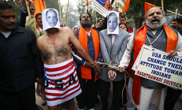 Supporters of Shivsena walk with people representing U.S. President Barack Obama near the U.S Embassy to protest against the alleged mistreatment of New York based Indian diplomat Devyani Khobragade, in New Delhi on Wednesday - AP