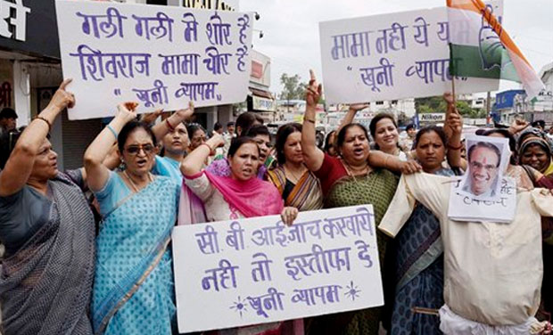 Mahila Congress activists burning an effigy of Madhya Pradesh Chief Minister Shivraj Singh Chouhan demanding his resignation into the death of the people linked with Vyapam scam, in Bhopal on Monday. (Photo: AP)
