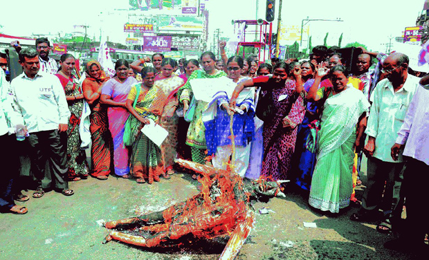 Protesters burn an effigy of film maker Ram Gopal Varma after seeing the poster at Jagadamba junction in Visakhapatnam.