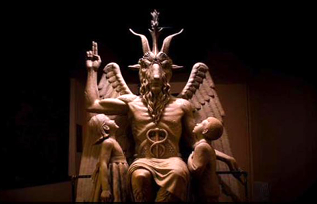 "The Satanic Temple unveiled the one-ton statue at an industrial building near the Detroit River just before 11:30 p.m. local time as supporters cheered, ""Hail Satan."" (Photo: Twitter)"