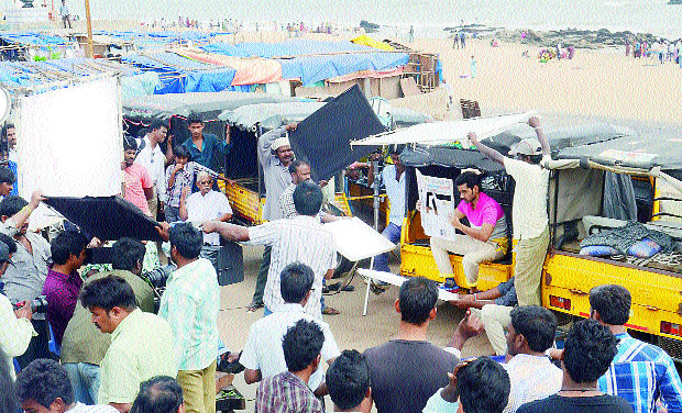 A file photo of shooting of a Tollywood movie, Chakkili Gintalu, featuring actor Sumath Ashwin in the lead, on the Beach Road in Visakhapatnam after Hudhud Cyclone. (Photo: DC)