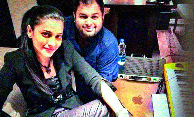 Shruti with music director Thaman