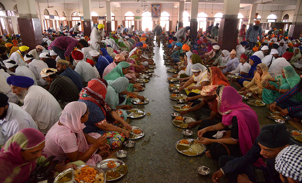Sikh devotees eat at Langar Ghar at the Golden Temple in Amritsar (Photo: AFP)