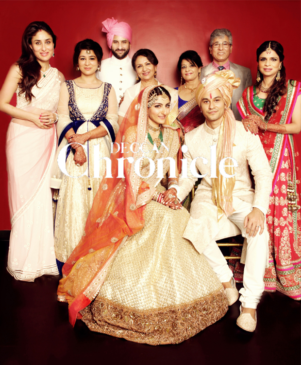 Picture perfect: The Khan and Khemu families pose for the wedding picture