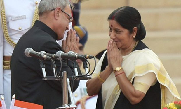 President Pranab Mukherjee greets newly sworn-in minister Sushma Swaraj after administering her the oath at a ceremony at Rashtrapati Bhavan in New Delhi on Monday. (Photo: PTI)