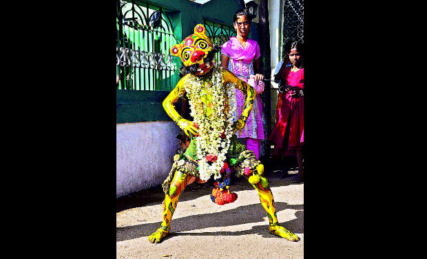 An artiste dressed and painted as a tiger which is a tradition during Moharram in districts of north Karnataka