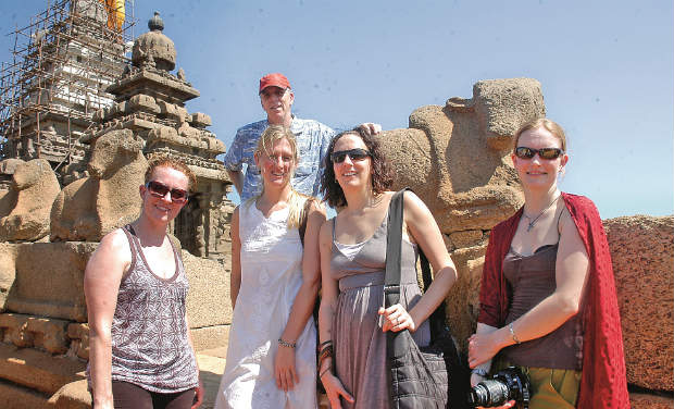 Foreigners posing in front of the shore temple in Mamallapuram 	-DC