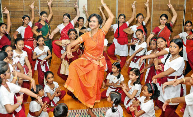 Dancer and guru Urmila Sathyanarayanan striking a mudra along with her students at her school Natya Sankalpaa.