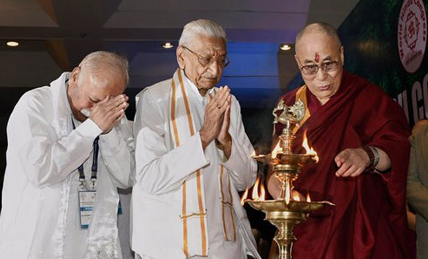 Tibetan spiritual leader the Dalai Lama lights the lamp as RSS chief Mohan Bhagwat and VHP leader Ashok Singhal join hands at the inauguration of World Hindu Congress 2014 in New Delhi on Friday. (Photo: AP)