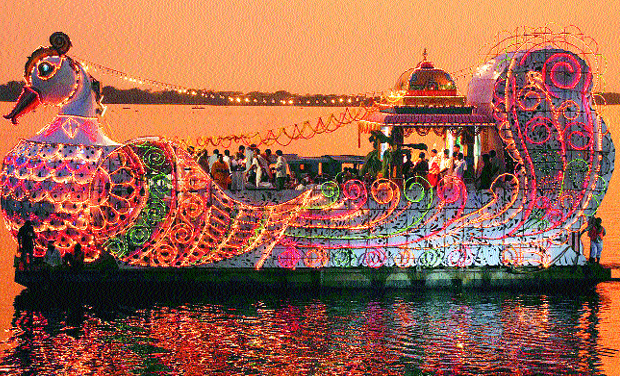 The exquisitely decorated Hamsa Vahanam floats on the River Krishna on Friday evening, to mark the conclusion of Dasara festivities.