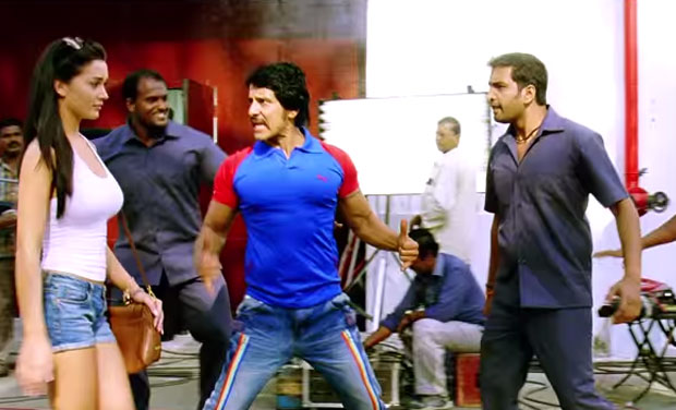 Amy Jackson and Vikram in a still fromt he song.