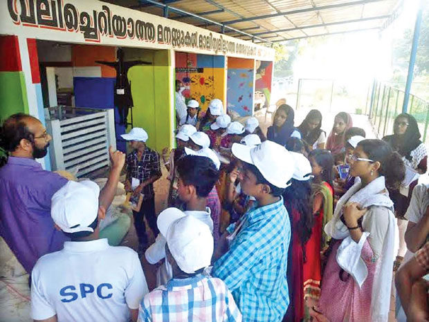 KSSP activist explains the functioning of the park; (inset) Families visit biogas plant unit in Alappuzha. (Photo: DC)