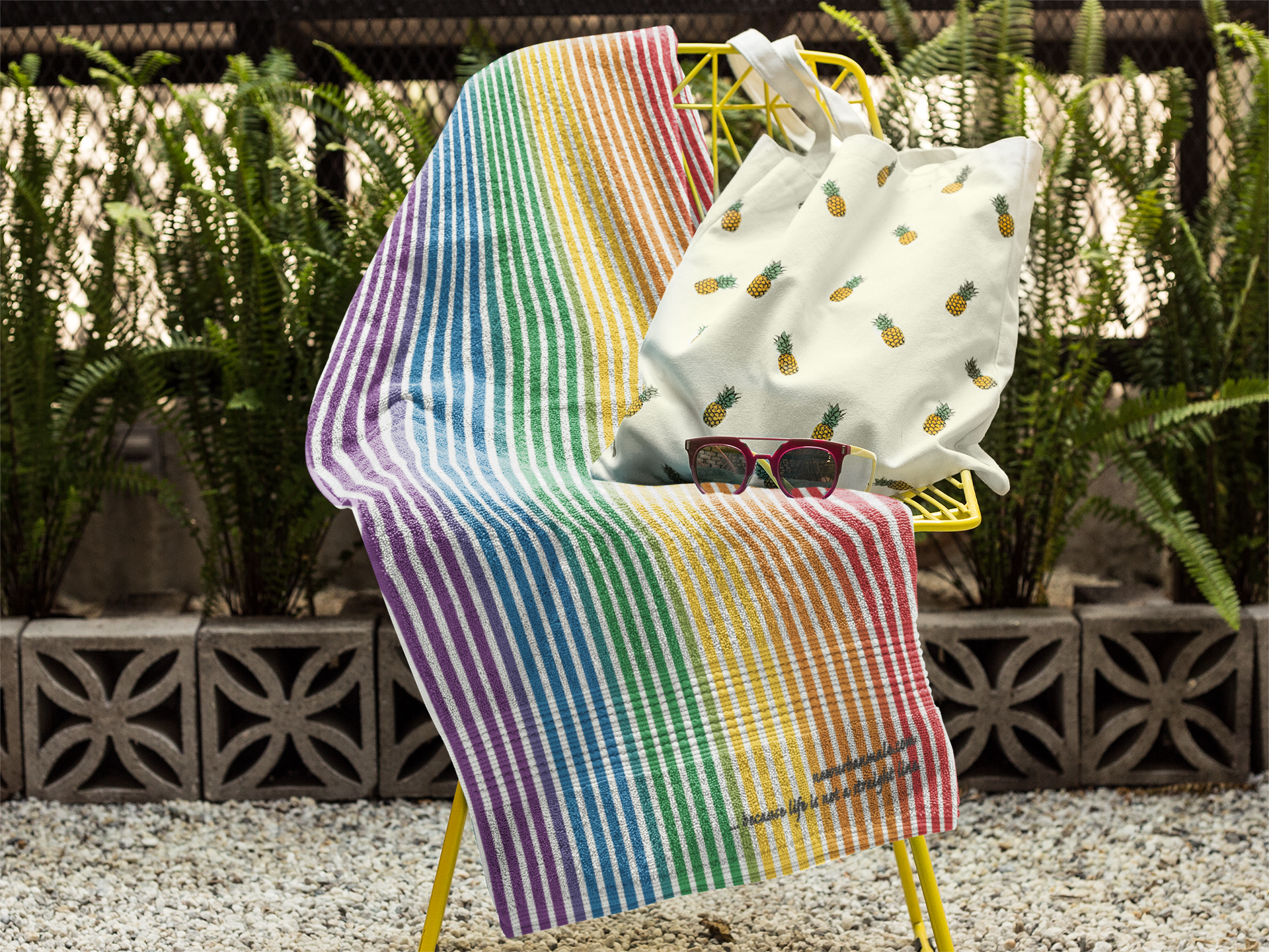towel-mockup-on-a-chair-with-a-pineapple-printed-bag-and-sunglasses-lying-on-it-a14899 (3).png