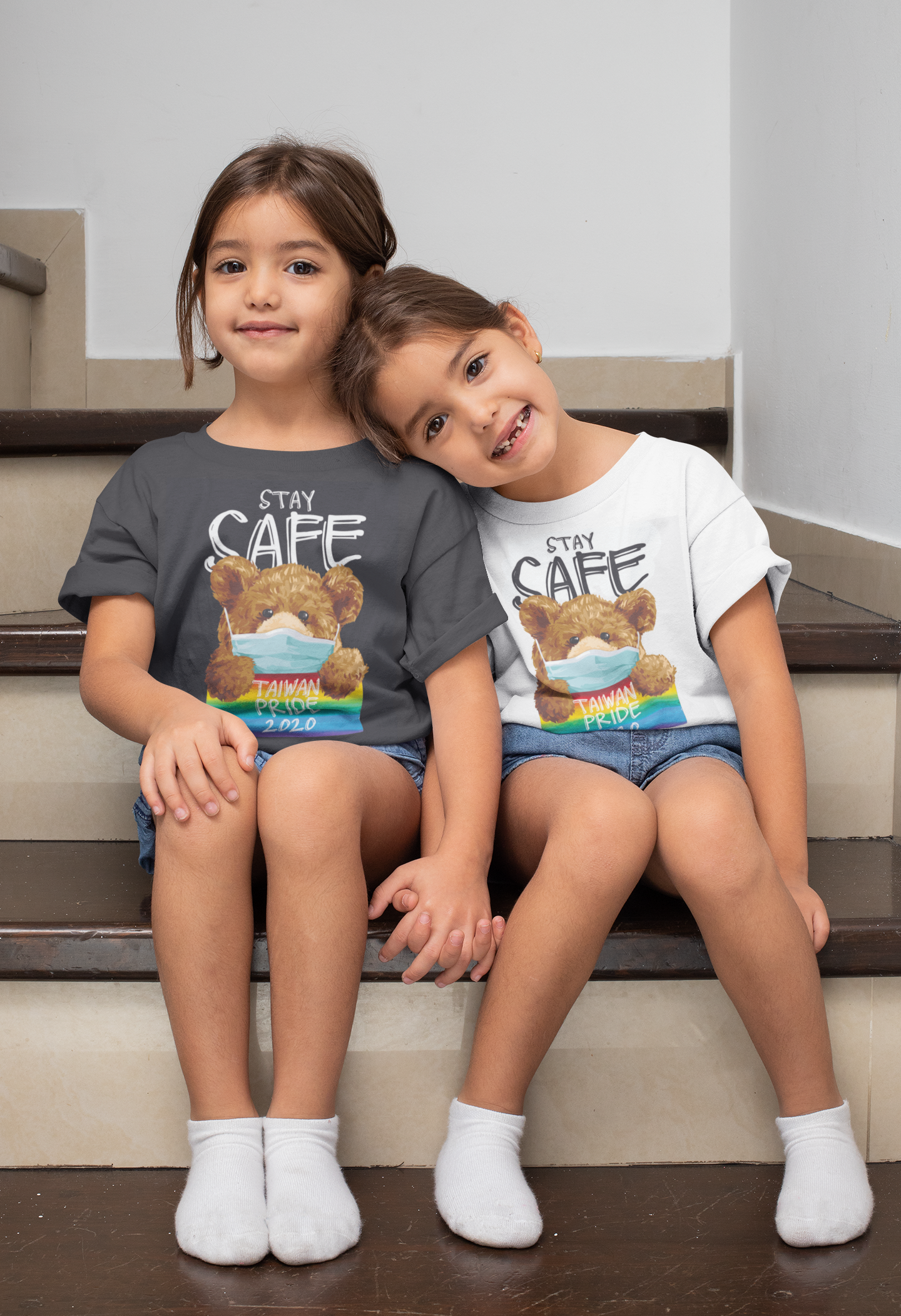t-shirt-mockup-of-twin-girls-sitting-on-the-stairs-31020.png
