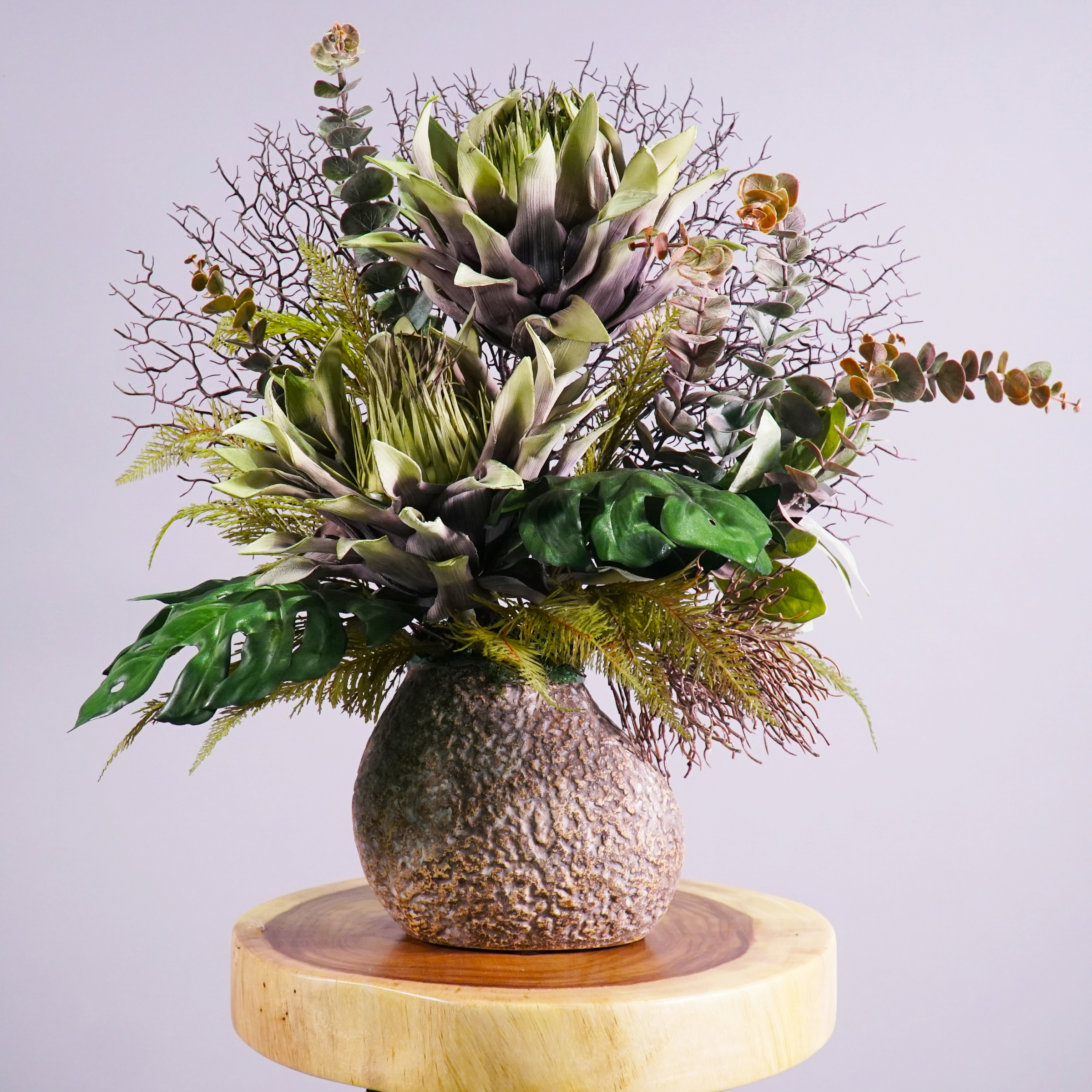 Artistic Lily Flower Decor in Stone Flower Pot.jpg