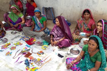 Bhil Tribe Women with their Products (Image Courtesy- Narendra Tripathi)