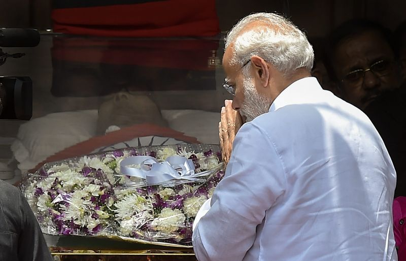 Prime Minister Narendra Modi pays his last respects to DMK chief M Karunanidhi at Rajaji Hall, in Chennai on Wednesday. (Photo: PTI)