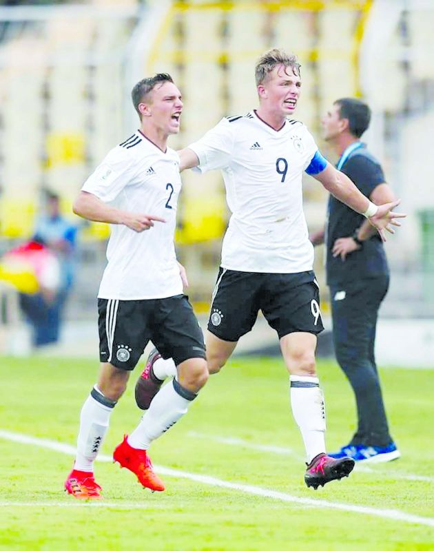 Jann-Fiete Arp (number 9) of Germany celebrates after scoring his team's first goal during a Group C match.