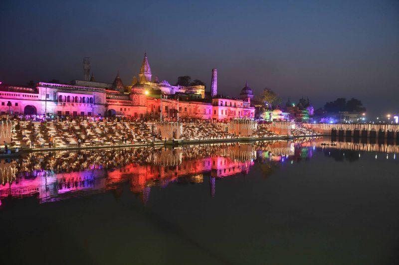 People lighting earthen lamps on banks of River Saryu during Deepotsav (Diwali celebrations) in Ayodhya on Wednesday. (Photo: PTI)