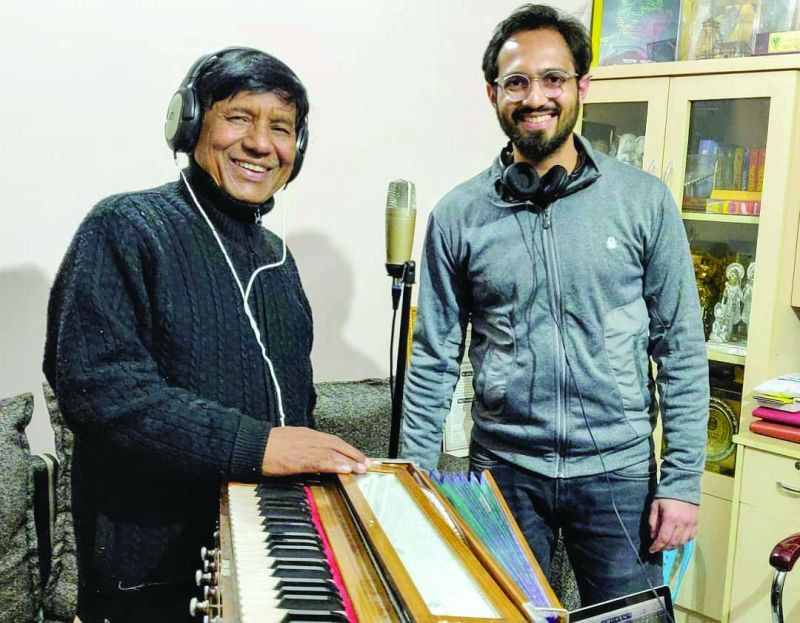 A behind-the-scenes photograph of Tushar and a musician.