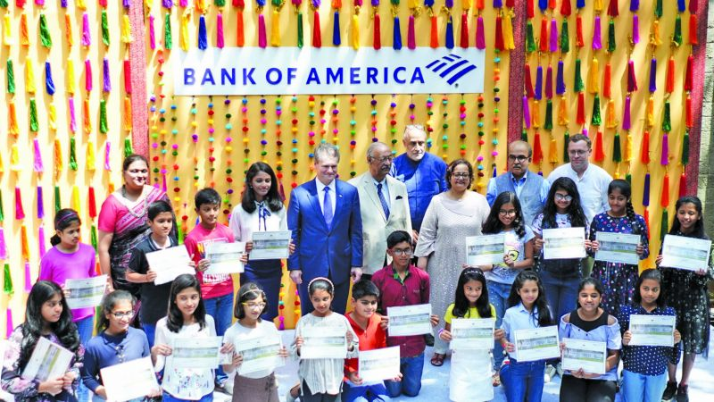 The young curators pose with Brian Moynihan, Chairman of the Board and CEO, Bank of America, (second row, 6th from left), Sabyasachi Mukherjee (second row, 5th from left) and others