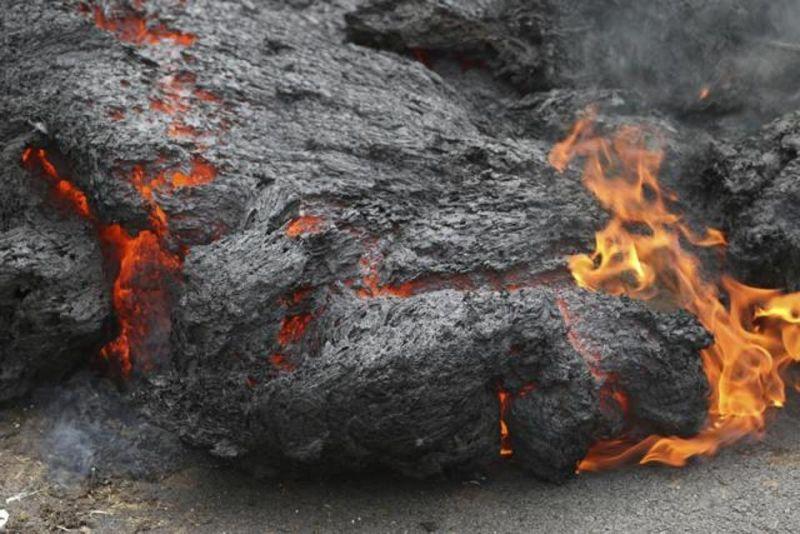 Lava burns across a road in the Leilani Estates subdivision, near Pahoa, Hawaii. (Photo: AP)