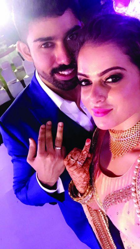 Alisha with husband Naveen