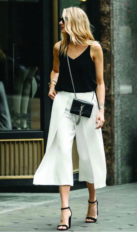 A white pair of culottes with a black tank top.