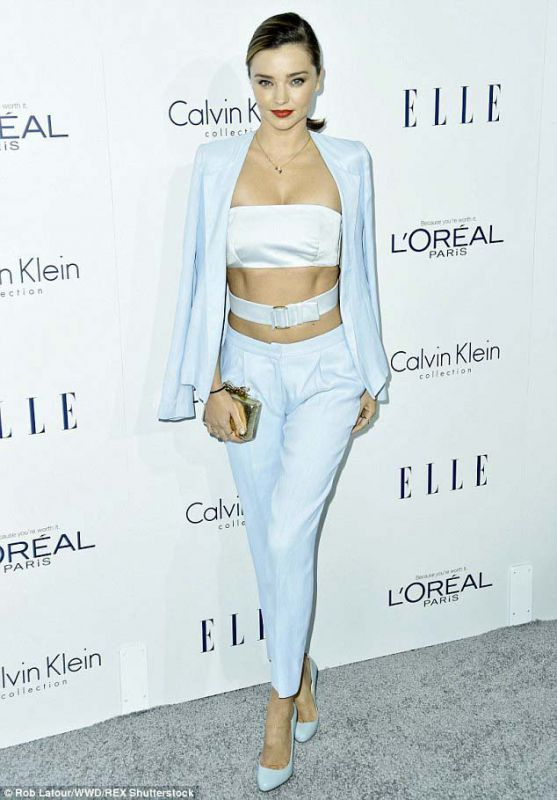 Miranda Kerr looks chic is this pale blue number