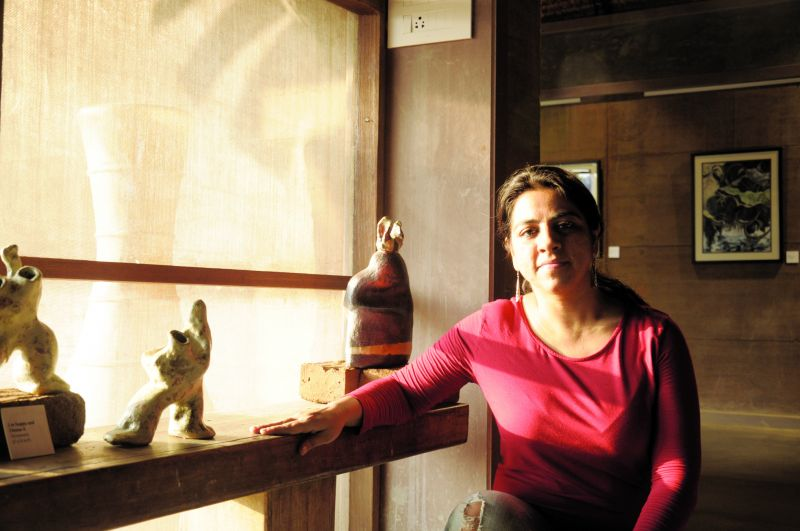 Potter Khushboo Madnani next to her ceramic works.