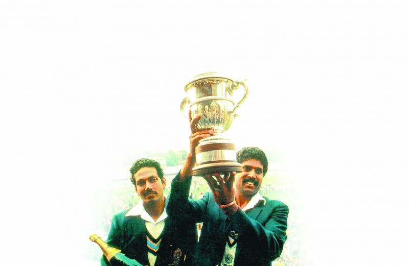 India skipper Kapil Dev holds the 1983 World Cup as Mohinder Amarnath looks on.