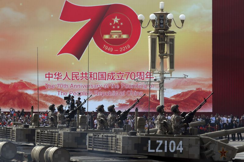 Army vehicles roll down during a parade to commemorate the 70th anniversary of the founding of Communist China in Beijing. (Photo: AP)