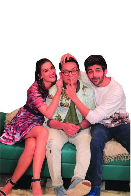 Kriti Sanon, Renil Abraham and Karthik Aaryan