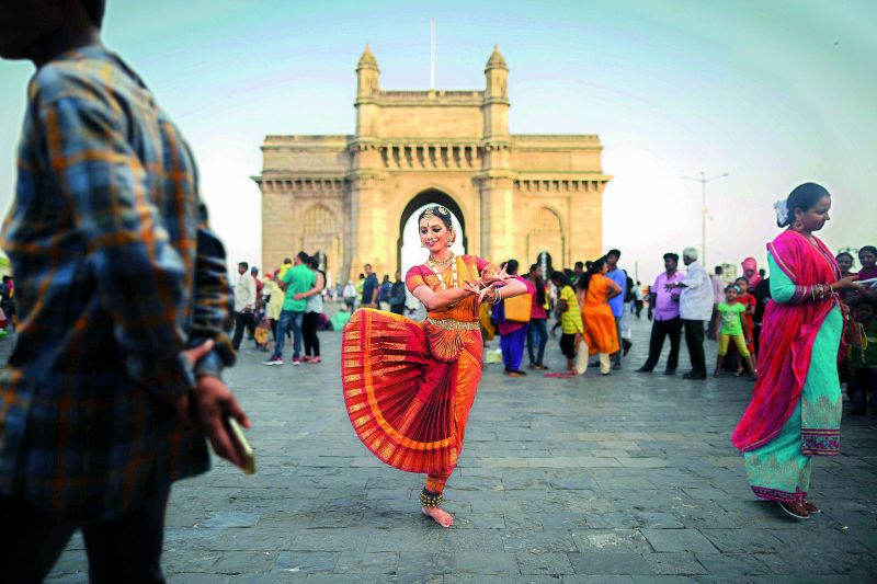 Bharatnatyam dancer placed against chaotic environment and ambiances near the Gateway of India