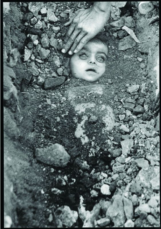 The iconic picture of a buried child from Bhopal gas tragedy.