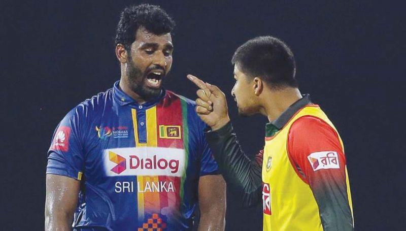 Thisara Perera and Nurul Hasan exchange heated words.