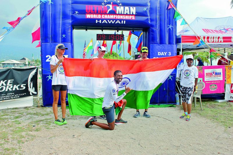 Finishing line: Manmadh poses with the Tricolor