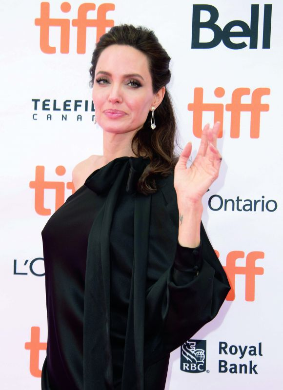 Angelina Jolie enjoys eating bugs because she learned that they were full of protein.