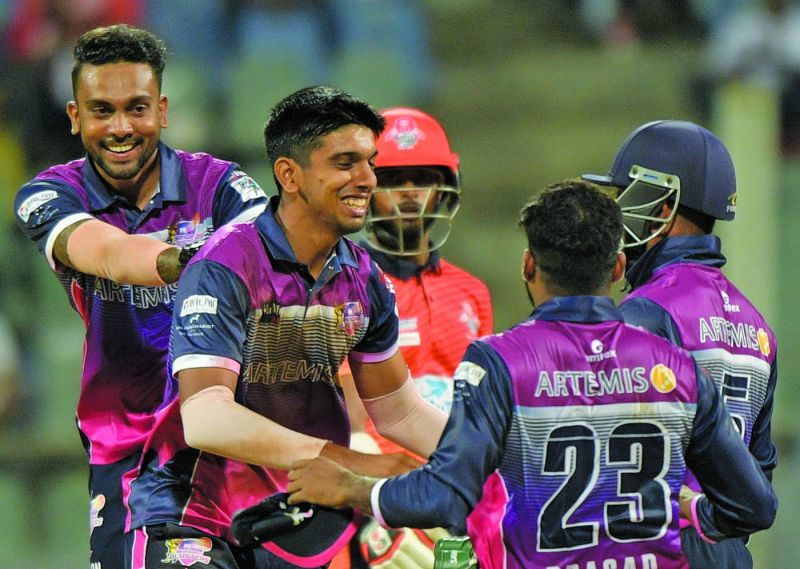 Karsh Kothari celebrating a wicket with his teammates