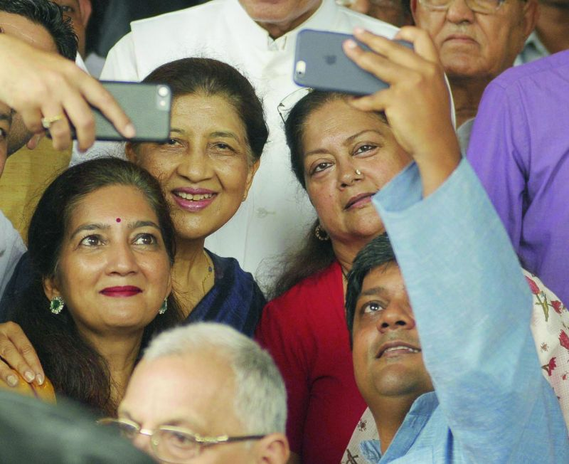 Guests take a selfie with Rajasthan chief minister Vasundhara Raje at Parliament House in New Delhi. (Photo: Asian Age)